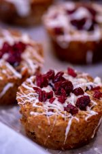 Baked oat cup with white chocolate and cranberries on top