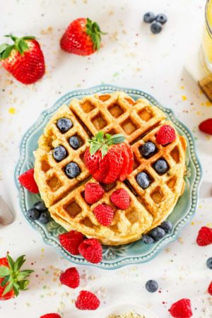 top down of waffle covered in fresh berries and ready for serving.