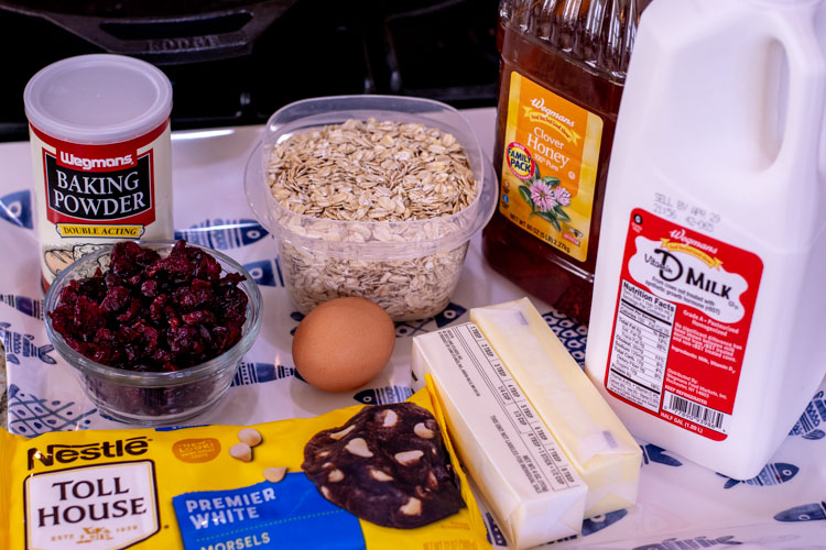 A platter with all of the necessary ingredients for the baked oatmeal cups