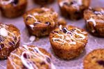 Oatmeal Cups on a Cooling Rack and Drizzled with White Chocolate