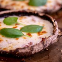 Delicious and Fresh Basil and Mozzarella Pizza on a Portobello Mushroom