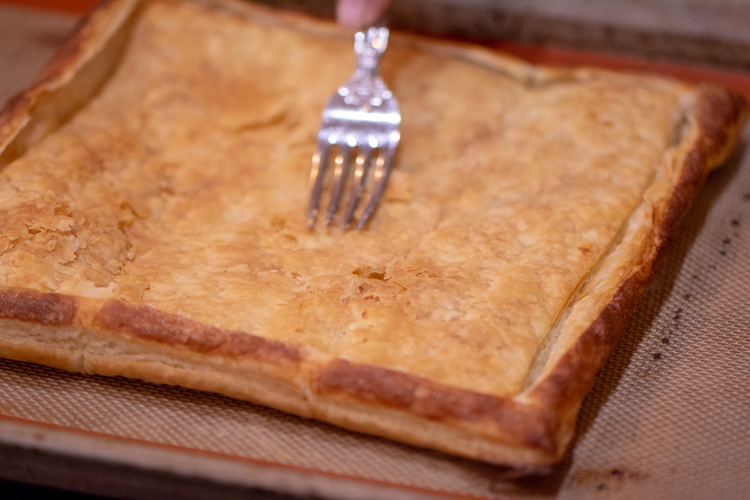 Puff Pastry out of the oven. If the interior needs flattening, use the flat side of the fork to gently press it down