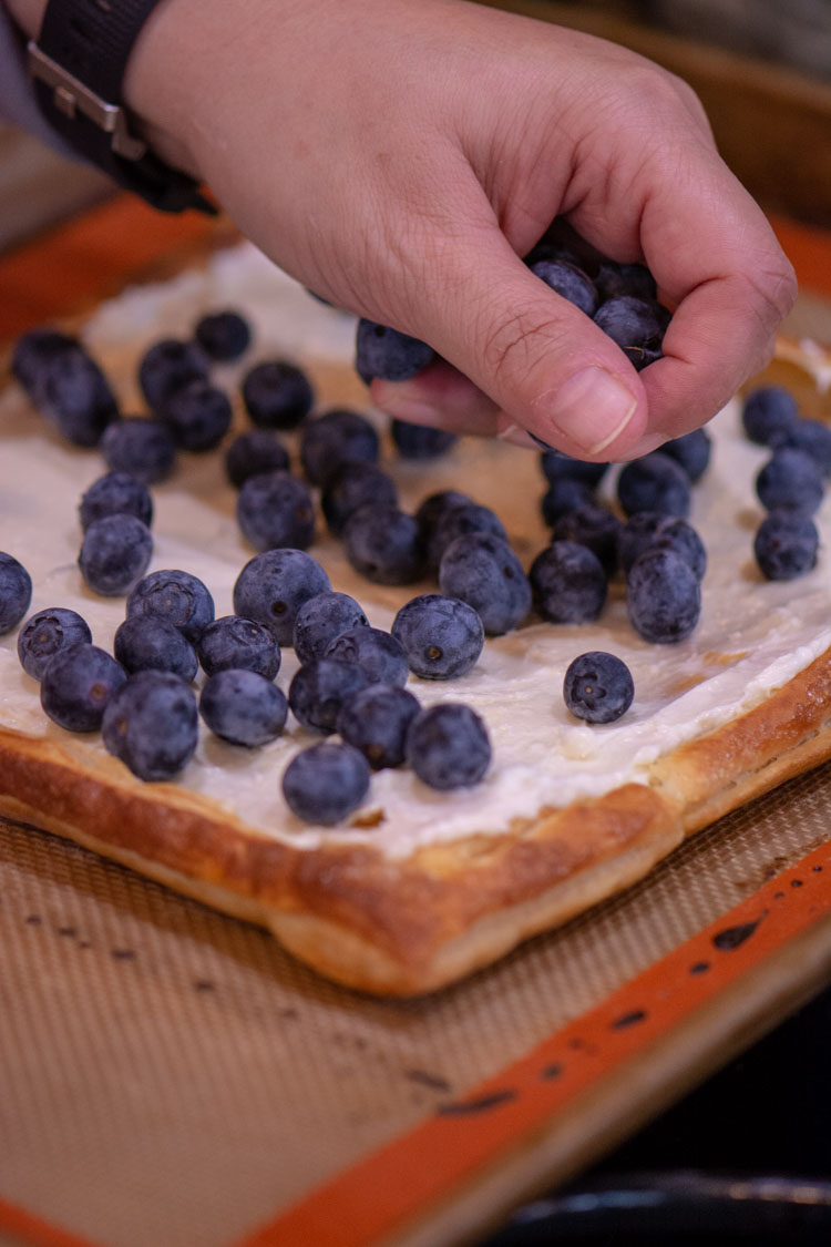 Adding the blueberries to the puff pastry and cream cheese