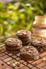 Stacked cake mix cookies with espresso powder on a cooling rack