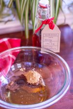 Glass bowl with Homemade vanilla extract and holiday spices