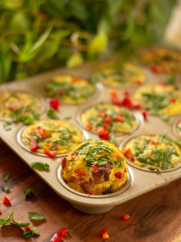 Egg Cups in a Muffin Tin on a Cutting Board