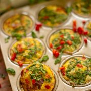Egg Cups Being removed from the muffin tin on a cutting board
