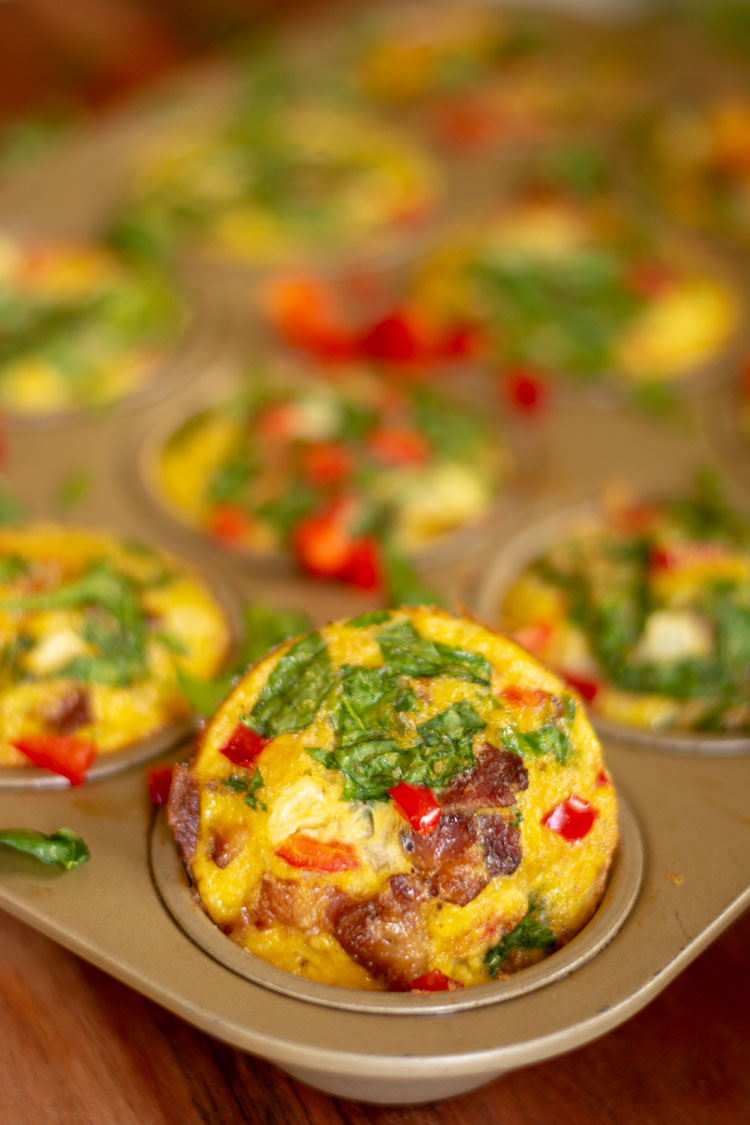 Spinach, Bacon and Peppers make this a colorful and delicious muffin tin egg cup