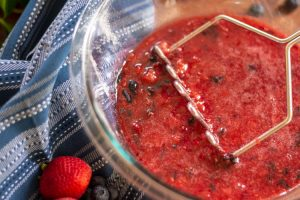 Use a masher to pulverize the fruit mixture to form the jam