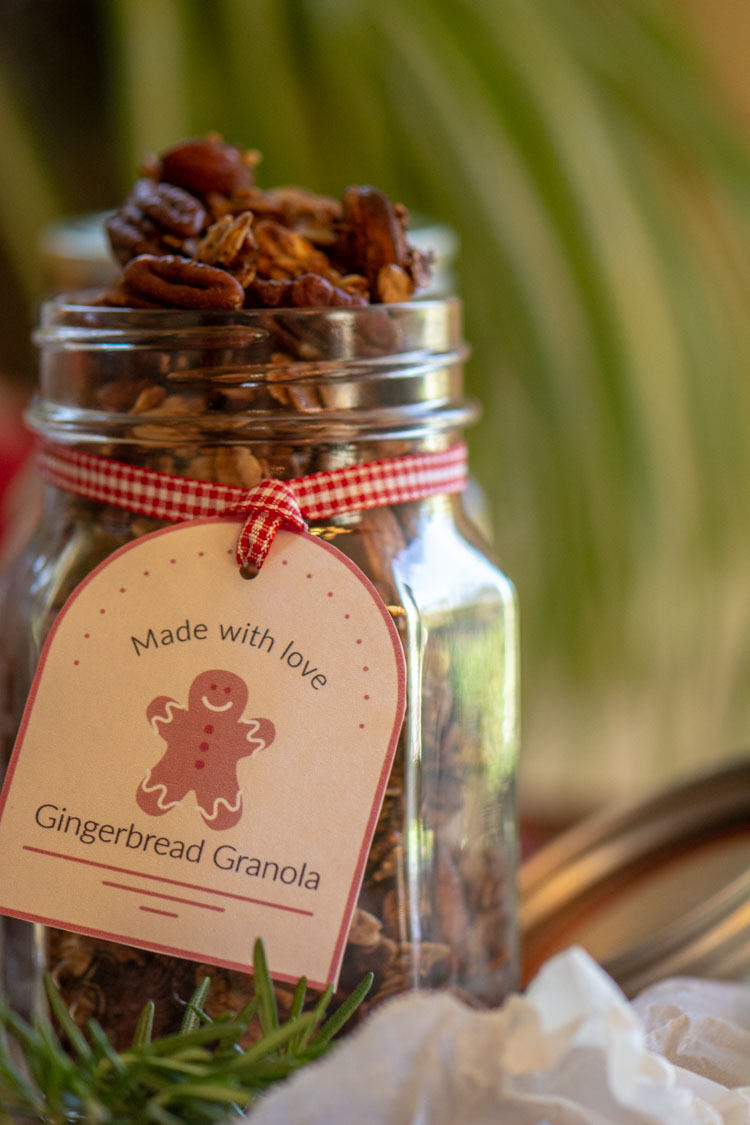 Mason Jar filled with toasted granola and a decorative gift tag