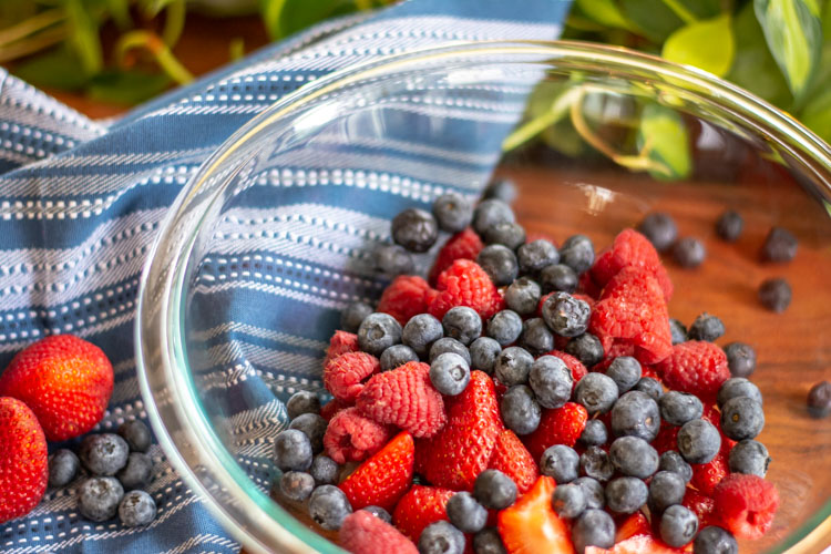 Strawberries, Raspberries and Blueberries in a glass bowl to begin the jam