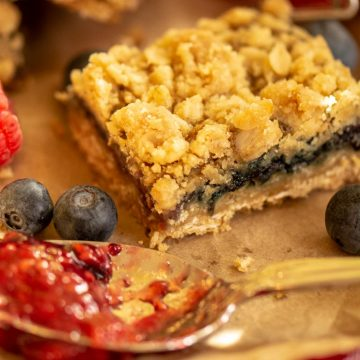 Sliced Mixed Berry Jam Bar with berries and a spoon of jam