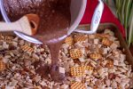 A Silver pan with the nutella mixture brought to a boil and poured over the chex mix and pretzel mixture