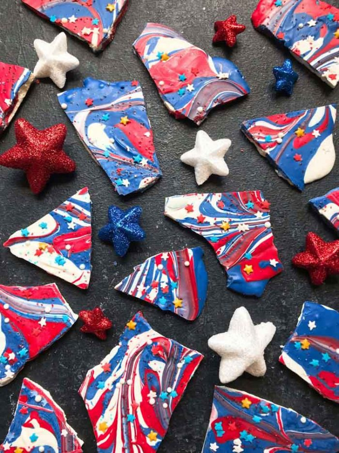 broken candy bark in red white and blue swirled together for a vibrant patriotic treat