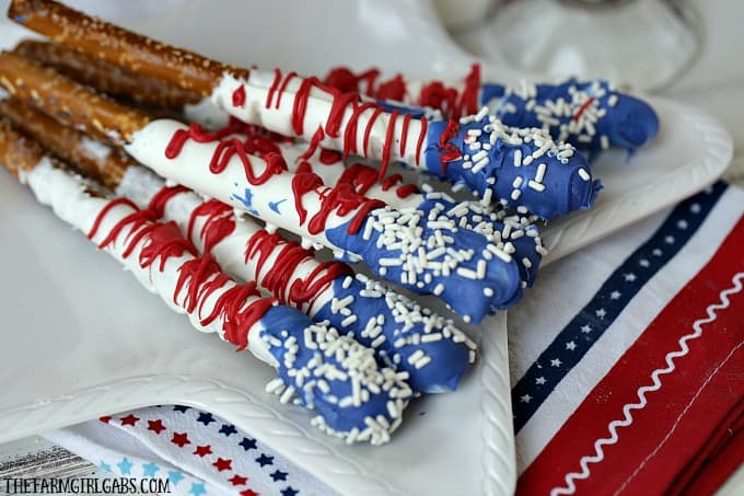 Chocolate covered pretzels with red white and blue frosting and white sprinkle stars