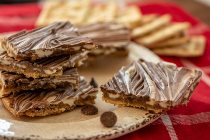 Plate of saltine toffee cookies with a triple chocolate topping