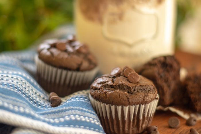 Close up of a muffin topped with chocolate chips with the gift jar in the background