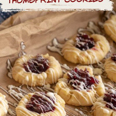Cranberry Bliss Thumbprint Cookies will have you craving the sweet and tangy mix for this year's Christmas Cookie Exchange #Cranberry #Cookie #Christmas #ChristmasCookie #Thumbprint #ThumbprintCookie