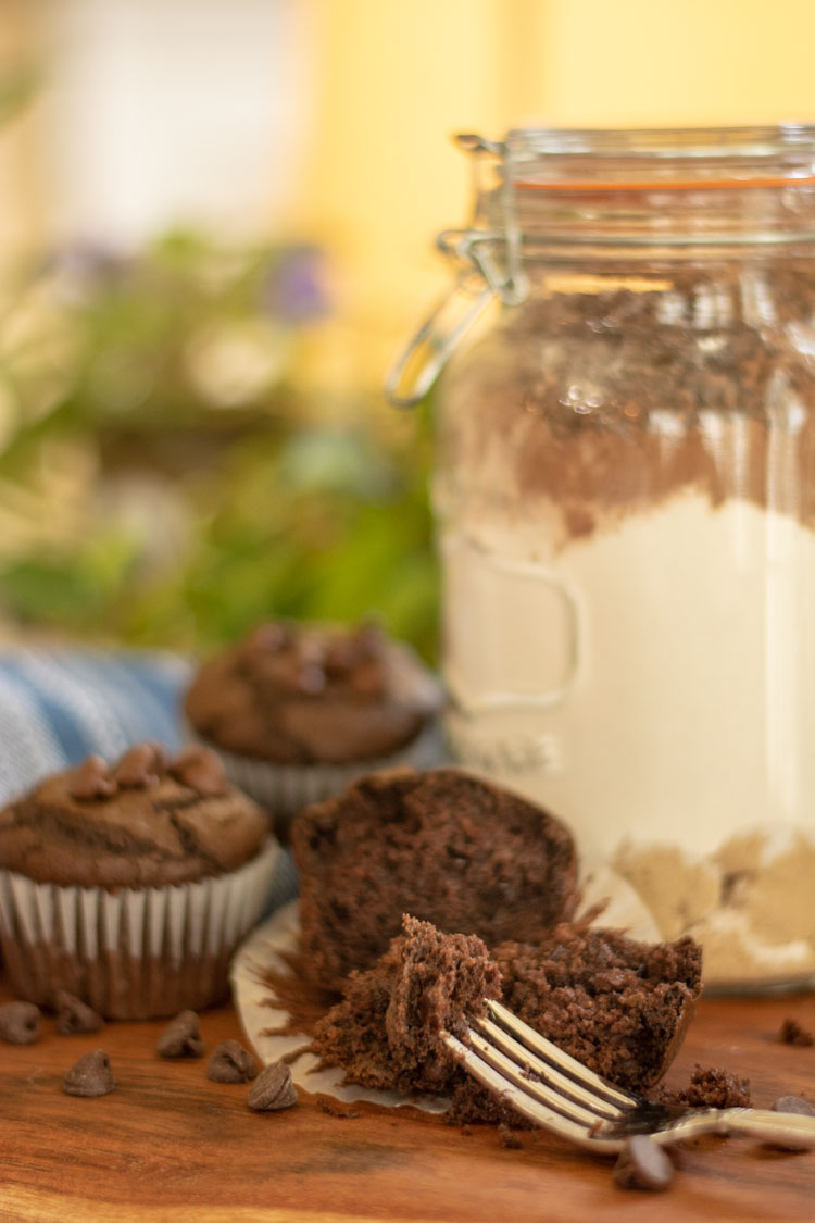 Muffin in a jar and a baked muffin with chocolate chips.