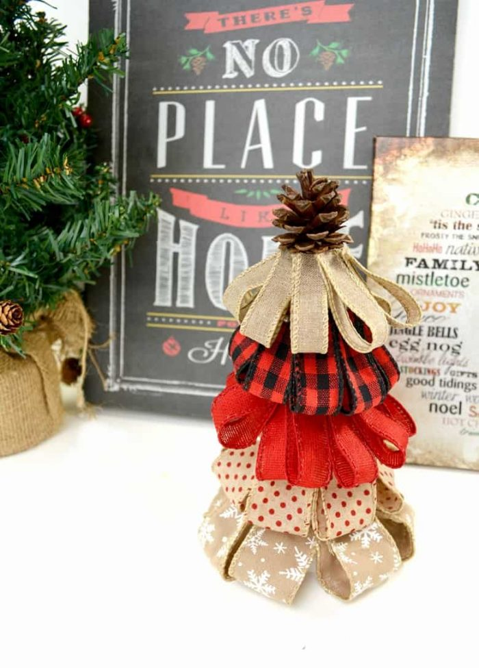 Holiday tree made from burlap in front of Christmas pictures and decor