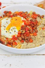 Savory Oatmeal with Cheese and Egg in a white bowl for a fantastic meal