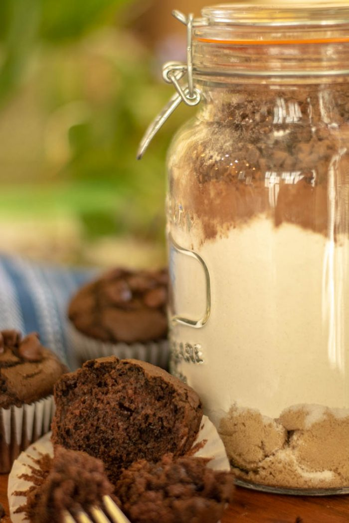 All the ingredients in a jar with the muffin in the foreground