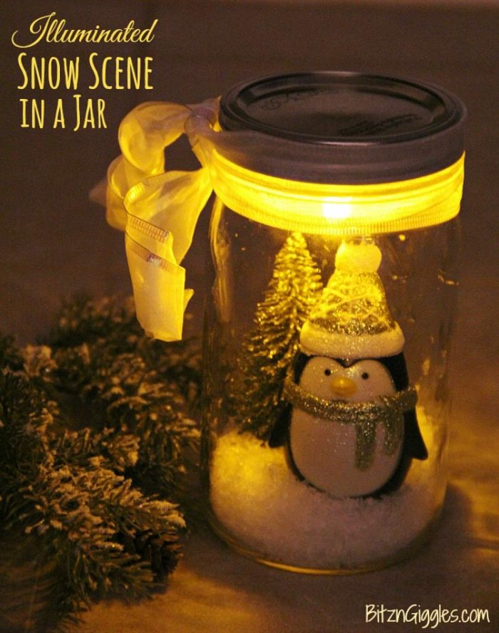 Jar with a tea light and a decorative scene of snow inside