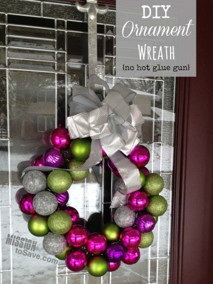 Purple and Green Holiday Wreath using a coat hanger on a glass door