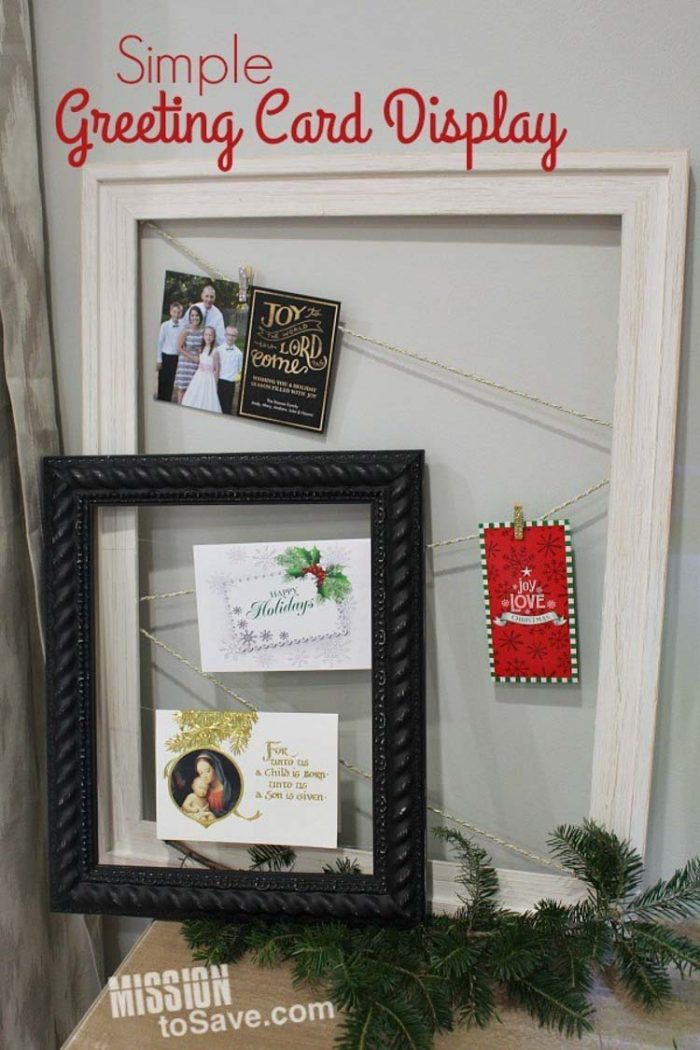 two picture frames with strings holding greeting cards for holiday display