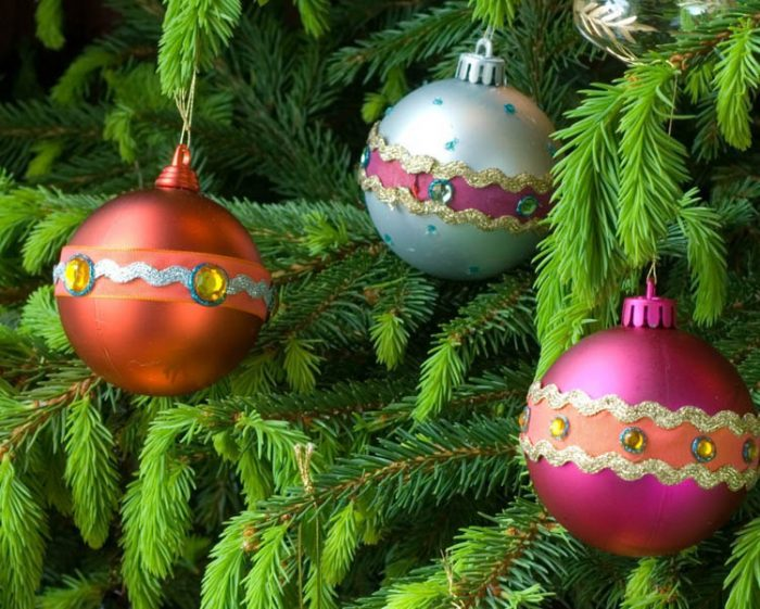 Adorable handmade holiday baubles as ornaments on a tree