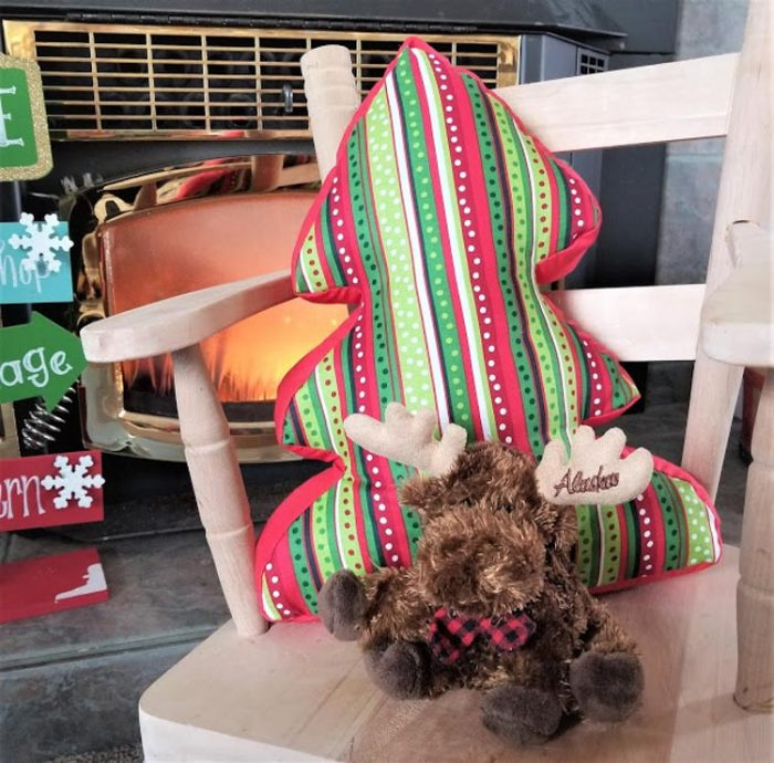 tree shaped pillow on a chair in holiday colors