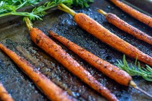 roasted carrots on cookie sheet after roasting in the oven