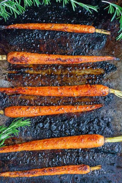top down view of sheet pan with balsamic roasted carrots and rosemary