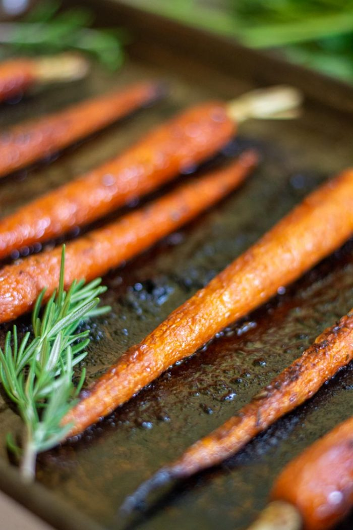 Honey Balsamic Sheet Pan Carrots with a Sprig of Rosemary
