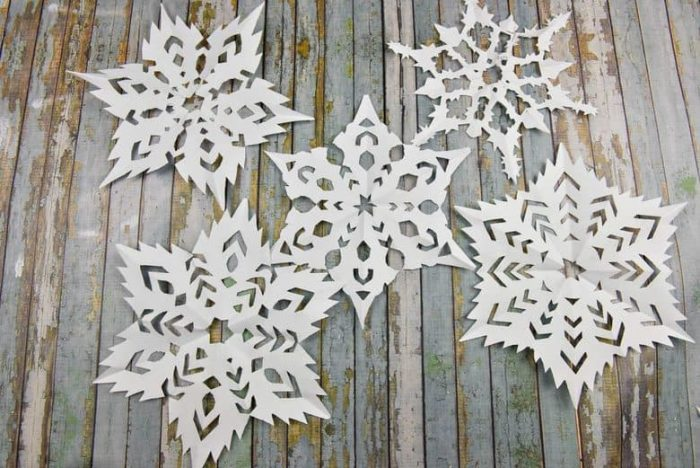 Paper snowflakes on a wooden background
