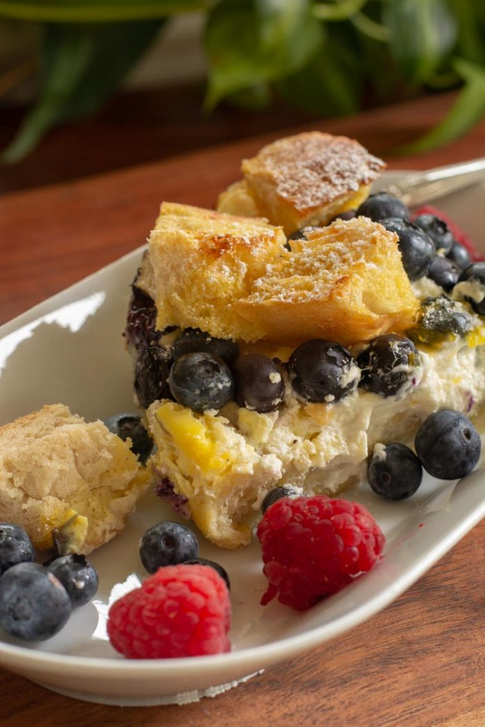 Serving dish with a slice of overnight french toast bake and fresh berries