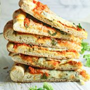 Stacks of pumpkin pizza slices with fresh arugula