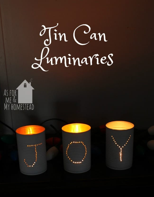 JOY spelled out in punched tin can luminaries