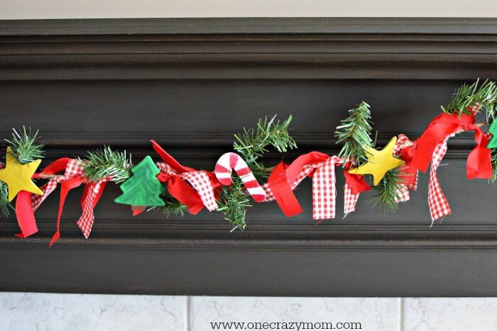 beautiful garland with homemade decor is a frugal on the mantle