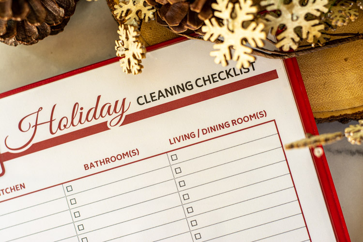 Holiday Cleaning Checklist Printable in a Red Binder