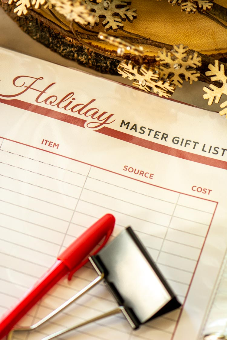 Holiday Master Gift List Printable in a plastic sheet protector in a red binder