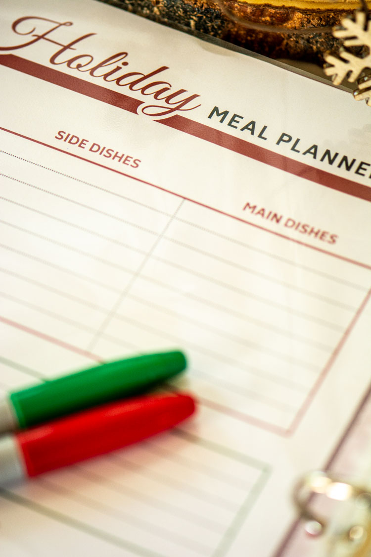 Holiday Meal Planner Free Printable that shows main and side dishes and two markers