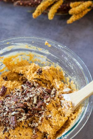 Fold in the crushed pecan chunks to the thick batter. All in a glass bowl