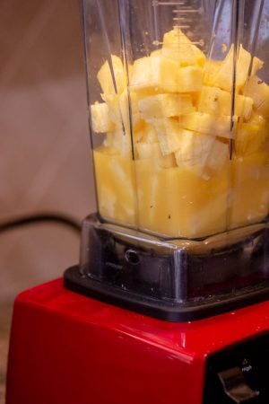 Use the Vitamix to blend the pineapple and mango or your fruits of choice