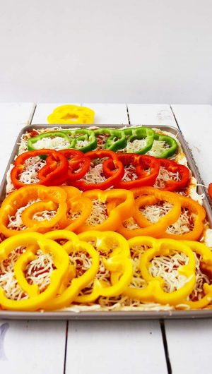 Layer the peppers on the sheet pan forming a rainbow of fun color.