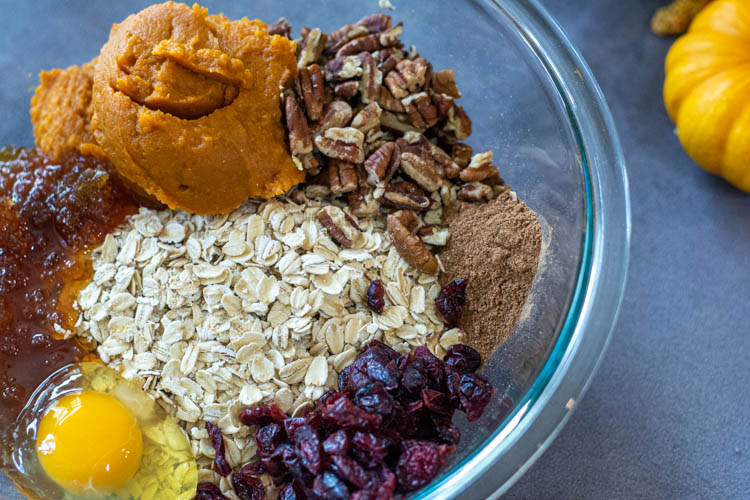 Glass bowl with the ingredients for the pumpkin oatmeal breakfast cookies