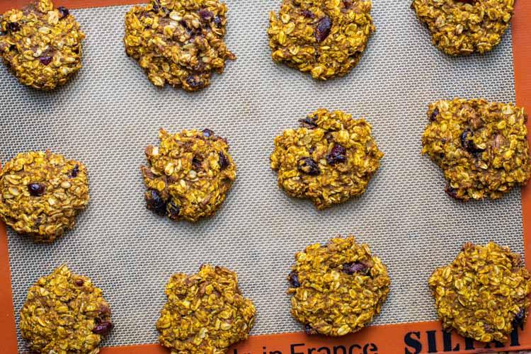 Top down view of breakfast cookies on a cookie sheet