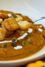 Pumpkin Soup Made with the Vitamix topped with pumpkin seeds, sour cream and fresh croutons