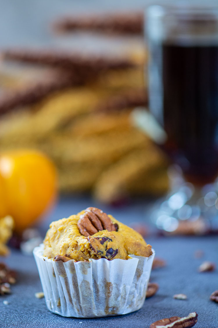 Closeup of a pumpkin muffin with a cup of coffee