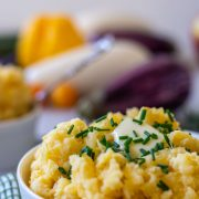 front view of a bowl of mashed rutabaga with fresh chives